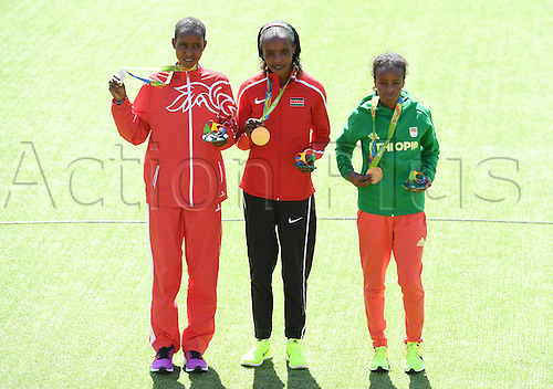 14.08.2016. Rio de Janeiro, Brazil. Silver medalist Eunice Jepkirui Kirwa (L) of Bahrain, Gold medalist Jemima Jelagat Sumgong of Kenya and Mare Dibaba (R) of Ethiopia celebrate during the medal ceremony of the Women's Marathon of the Athletic, Track and Field events during the Rio 2016 Olympic Games at Sambodromo in Rio de Janeiro, Brazil, 14 August 2016.