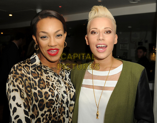 Stooshe (Karis Anderson, Courtney Rumbold)<br /> 'Bloggers Love' Gifting Suite Event at the Penthouse, Leicester Square. London, England.<br /> 17th September 2013<br /> half length white blazer brown green leopard print top mouth open band group red lipstick mouth open<br /> CAP/PP/GM<br /> &copy;Gary Mitchell/PP/Capital Pictures