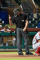 Umpire Nic Lentz signals for two baseballs during an Arizona Fall League game between the Mesa Solar Sox and Scottsdale Scorpions on October 20, 2015 at Scottsdale Stadium in Scottsdale, Arizona.  Mesa defeated Scottsdale 5-4.  (Mike Janes/Four Seam Images)