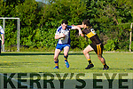 Garreth O'Connor Keel stops Keels Colm O'Neill during their County league clash in Currow on Saturday