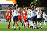 (left) Steph Houghton and (right) Millie Bright of England Women applauds the fans at the final whistle during the FIFA Women's World Cup Qualifier match between Wales and England at Rodney Parade on August 31, 2018 in Newport, Wales.