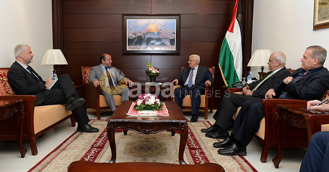 Palestinian President, Mahmoud Abbas (Abu Mazen) meets with representative of the European Union, John Rutter grat, in the West Bank city of Ramallah on April 25, 2015. Photo by Osama Falah
