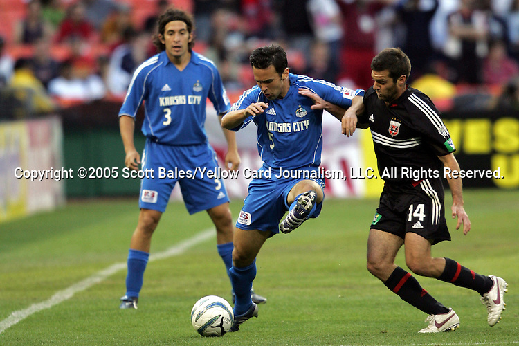 21 May 2005: Kansas City's Kerry Zavagnin (5) holds off DC United's Ben Olsen (14). DC United defeated the Kansas City Wizards 3-2 at RFK Stadium in Washington, DC in a regular season Major League Soccer game. .