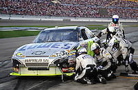 Mar. 1, 2009; Las Vegas, NV, USA; NASCAR Sprint Cup Series driver Jimmie Johnson pits after crashing during the Shelby 427 at Las Vegas Motor Speedway. Mandatory Credit: Mark J. Rebilas-