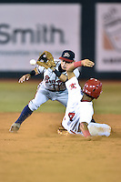 Danville Braves second baseman Omar Obregon #2 fields the throw and attempts to apply the tag as Oscar Mercado #4 slides in safely during a game against the Johnson City Cardinals at Howard Johnson Field September 4, 2014 in Johnson City, Tennessee. The Braves defeated the Cardinals 6-1. (Tony Farlow/Four Seam Images)