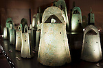 Photo shows bronze bells dating back around 2,000 years and excavated from the Kamo-Iwakura site on display at the Shimane Museum  of Ancient Izumo, which was designed by Maki Fumihiko,  in Izumo City, Shimane Prefecture, Japan on 05 Nov. 2012.  The bells are designated important cultural properties. In 1996, 39 bronze vessels (bronze bells) were excavated -- the largest number excavated from a single site in Japan. These bronze implements are thought to have been used in the religious festivals and are evidence that the Gods festivals in Izumo were regarded as highly significant. Photographer: Robert Gilhooly