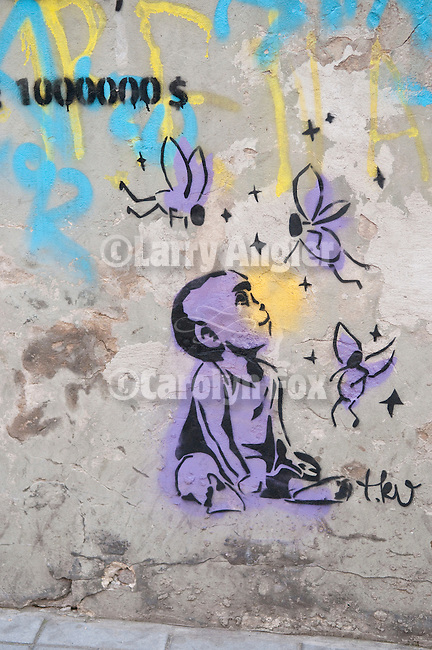 Colorful graffiti painted on a wall featuring a lavender baby and flittering angels, Belgrade, Serbia