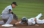 Reno Aces' Taylor Harbin dives under the tag of Salt Lake's Efren Navarro during a minor league baseball game in Reno, Nev., on Sunday, Aug. 25, 2013. The Salt Lake Bees won 9-1. <br /> Photo by Cathleen Allison