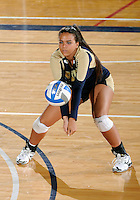 Florida International University women's volleyball player Paola Ortiz (11) plays against Tulane University.  FIU won the match 3-2 on September 9, 2011 at Miami, Florida. .