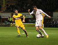 Clark Robertson clears under pressure from Keith Lasley in the Motherwell v Aberdeen, Clydesdale Bank Scottish Premier League match at Fir Park, Motherwell on 26.12.12.