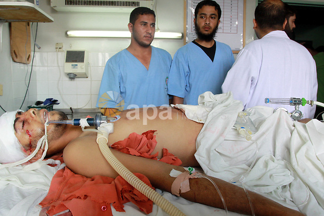 Palestinian medics check a wounded man at Al-Shifa hospital following and Israeli strike on July 21, 2010 in Beit Hanun, near the border with Israel in the northern Gaza Strip, in which one person was killed and 10 others were wounded.. Photo by Mohammed Asad