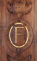 Sculpted wooden panel with gilded initial F for King Francois I, in the Galerie Francois I, begun 1528, the first great gallery in France and the origination of the Renaissance style in France, Chateau de Fontainebleau, France. The Palace of Fontainebleau is one of the largest French royal palaces and was begun in the early 16th century for Francois I. It was listed as a UNESCO World Heritage Site in 1981. Picture by Manuel Cohen