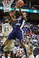 February 08, 2011:   North Florida Ospreys guard Brad Haugabrook (1) goes up for a layup while being defended by Jacksonville Dolphins forward Delwan Graham (21) during Atlantic Sun Conference action between the Jacksonville Dolphins and the North Florida Ospreys at Veterans Memorial Arena in Jacksonville, Florida.  Jacksonville defeated North Florida 71-69.
