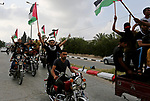 """Palestinians take part  in a demonstration demanding the right of return and removal of the blockade following the """"Great March of Return"""" iin Khan Younis in the southern Gaza Strip June 28, 2018. Photo by Ashraf Amra"""