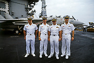 24 Aug 1981 --- Lieutenants, and radar specialists, James Anderson (L) and David Venlet (R), with pilots Lawrence Muczynski (second, L) and, commander, Henry Kleeman aboard the American supercarrier and warship USS Nimitz, during the Gulf of Sidra incident. --- Image by © JP Laffont
