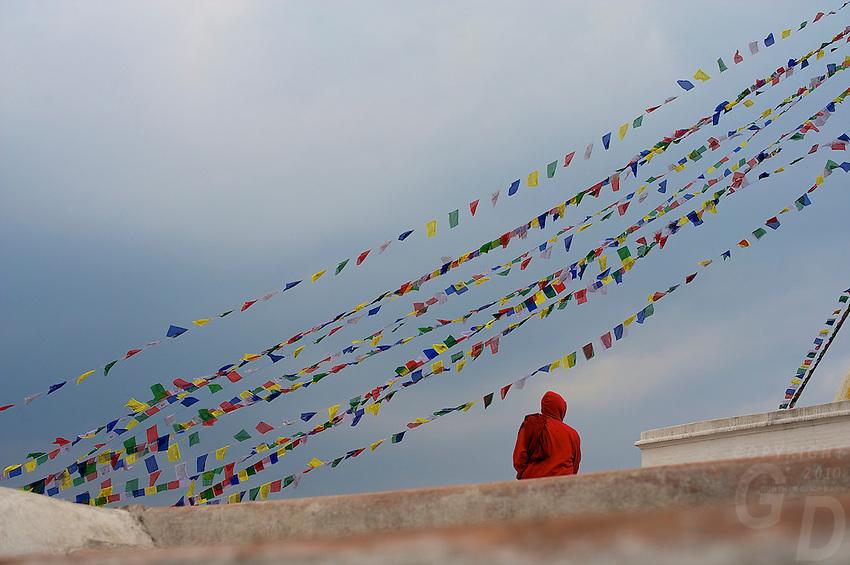 Buddhist Monk pilgrim at the Boudhanath stupa Kathmandu also known as little Tibet, Nepal