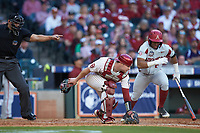 Oklahoma Sooners catcher Justin Mitchell (14) picks up the baseball as home plate umpire Michael Banks indicates it is a fair ball off the bat of Christian Franklin (25) of the Arkansas Razorbacks in game two of the 2020 Shriners Hospitals for Children College Classic at Minute Maid Park on February 28, 2020 in Houston, Texas. The Sooners defeated the Razorbacks 6-3. (Brian Westerholt/Four Seam Images)