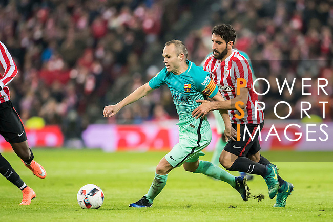 Andres Iniesta Lujan (l) of FC Barcelona battles for the ball with Raul Garcia of Athletic Club during their Copa del Rey Round of 16 first leg match between Athletic Club and FC Barcelona at San Mames Stadium on 05 January 2017 in Bilbao, Spain. Photo by Victor Fraile / Power Sport Images