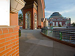 Tacoma, WA<br /> Arched brick entry and plaza of the Washington State History Museum with a view of Union Station - now Tacoma's Federal Courthouse