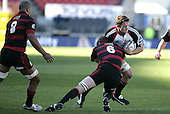 Michael Paterson feels the full force of a Kristian Ormsby charge during the Ranfurly Shield challenge against Canterbury at Jade Stadium on the 10th of September 2006. Canterbury won 32 - 16.