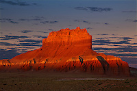 751000027 wild horse butte at sunrise near the entrance to goblin valley state park in north central utah