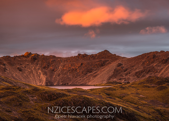 Pristine Lake Angelus with Angelus Hut under dramatic sunset, Nelson Lakes National Park, South Island, New Zealand, NZ