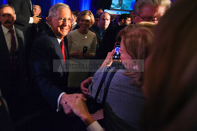 Kentucky Senator Mitch McConnell shakes supporter Kim Getz's hand in Louisville, Ky.,on Tuesday, November 4, 2014. Photo by Michael Reaves | Staff