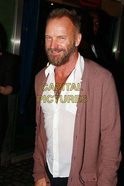 STING (GORDON SUMNER).Attends the photography exhibition 'The People of the Forest' - 20 years of images from the Rainforest Foundation, Proud Gallery, Camden, London, England,  October 6th 2009..half length beard facial hair white shirt necklace pink cardigan smiling brown.CAP/MAR.© Martin Harris/Capital Pictures.
