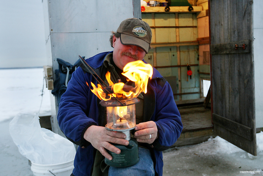 Smelt fisherman John Standley of Brentwood lights a lamp for his ice shack on Great Bay in Newington, N.H. Sunday,  January, 24, 2010.  (Portsmouth Herald Photo/Cheryl Senter)