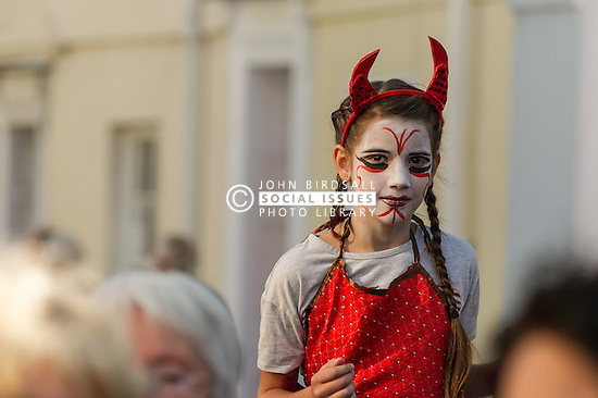 A young girl dressed as an imp in the Penryn Festival in Cornwall