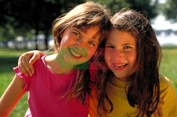 portrait of laughing young girls in park