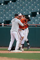 Bowie Baysox Ryan McKenna (center) celebrates with teammates Stuart Levy (sweatshirt) and Willy Yahn (back) after laying down a game winning squeeze play bunt during an Eastern League game against the Binghamton Rumble Ponies on August 21, 2019 at Prince George's Stadium in Bowie, Maryland.  Bowie defeated Binghamton 7-6 in ten innings.  (Mike Janes/Four Seam Images)