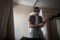 Dimitri Bontinck, a 39 years old belgium gets ready at his hotl room in Kilis border town as he heads towards Syria in his attemp to find out his son, a youth belgium who has turned himself into a Islamic fighter who is battling Syrian government army beside radical Muslim groups at the northern of Syria.
