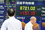 June 18, 2012, Tokyo, Japan - A businessman looks at the stock market board showing the figure for the Nikkei 225 in downtown Tokyo. The Nikkei 225 climbed 151.70 points to 8,721.02 at Tokyo's 3pm closing. Greece's positive election vote helped ease fears that the country may fall out from the euro currency. (Photo by Christopher Jue/AFLO)