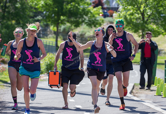 The Sax Addicts team crosses the finish line at the 2019 Reno Tahoe Odyssey at Idlewild Park in Reno on Saturday, June 1, 2019.