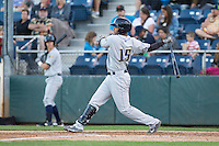 Miguel Dilone #15 of the Tri-City Dust Devils at bat during a game against the Everett AquaSox at Everett Memorial Stadium in Everett, Washington on July 28, 2014. Tri-City defeated Everett 6-5 in 11 innings.  (Ronnie Allen/Four Seam Images)
