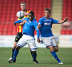 St Johnstone v Partick Thistle...28.09.13      SPFL<br /> Christie Elliot grabs a hold of Nigel Hasselbaink<br /> Picture by Graeme Hart.<br /> Copyright Perthshire Picture Agency<br /> Tel: 01738 623350  Mobile: 07990 594431