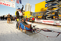 Rick Larson leaves the start line at the Anchorage start of Iditarod 2009