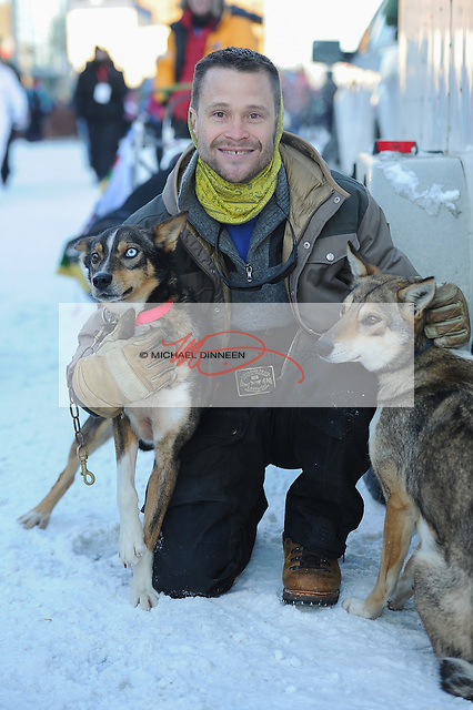 Eagle RIver musher Larry Dougherty with Sarah Jane and Magic, two of his team dogs at the ceremonial start of the Iditarod Trail Sled Dog Race in downtown Anchorage.  Photo for the Star by Michael Dinneen.