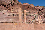 Stone columns in front of the theater on the Street of Facades in the Nabataean city of Petra in the Hashemite Kingdom of Jordan.  Petra Archeological Park is a Jordanian National Park and a UNESCO World Heritage Site.