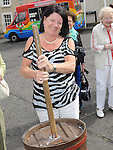 Kathleen Doyle enjoys churning butter at the open day at Millmount Square. Photo: Colin Bell/pressphotos.ie