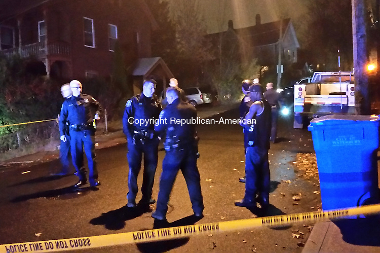 Police investigate a shooting on Bank Street in Waterbury Monday night. Michael Puffer/ Republican-American