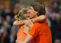 Februari 08, 2015, Apeldoorn, Omnisport, Fed Cup, Netherlands-Slovakia, Arantxa Rus (NED)  jubilates her victory Holland wins 3-1 and falls into the arms of captain Paul Haarhuis<br /> Photo: Tennisimages/Henk Koster