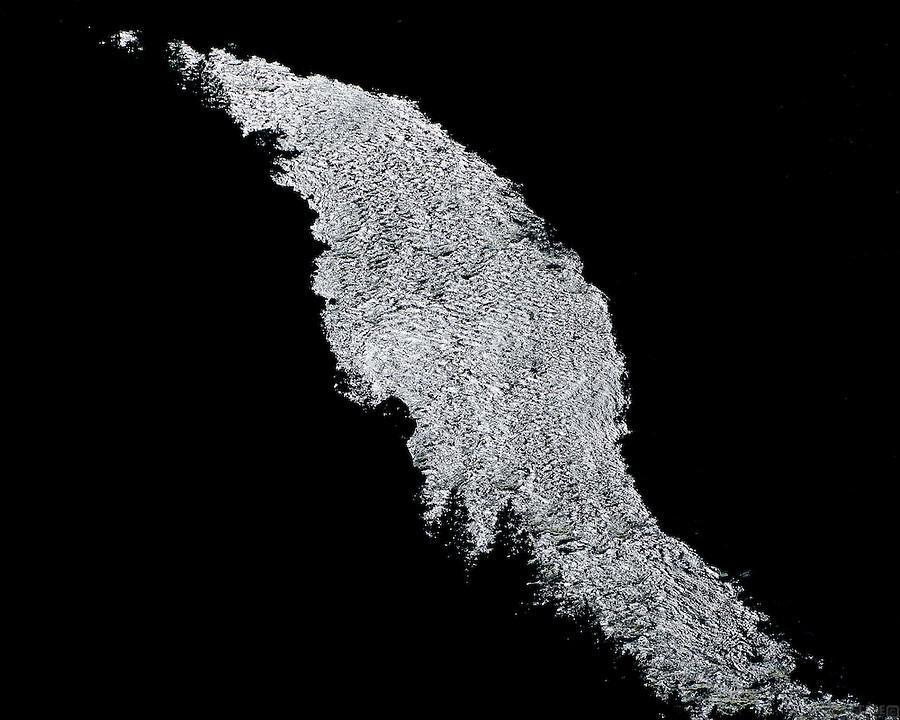 The silver sliver of the Colorado River winds through Gore Canyon in Colorado's central mountains.