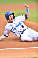 Asheville Tourists center fielder Will Golsan (8) slides into third base during a game against the Augusta GreenJackets at McCormick Field on April 5, 2019 in Asheville, North Carolina. The  Tourists defeated the GreenJackets 5-0. (Tony Farlow/Four Seam Images)