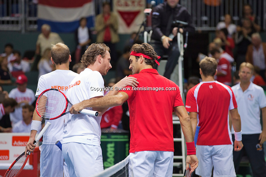 Switserland, Genève, September 19, 2015, Tennis,   Davis Cup, Switserland-Netherlands, Doubles: Matwe Middelkoop and Thiemo de Bakker  (L) are congratulated by FedererChiudinerlli <br /> Photo: Tennisimages/Henk Koster