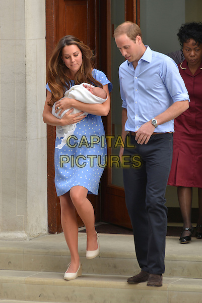 Prince William, Duke of Cambridge and Catherine, Duchess of Cambridge, depart The Lindo Wing with their newborn son at St Mary's Hospital on July 23, 2013 in London, England. The Duchess of Cambridge (Kate) yesterday gave birth to a boy at 16.24 BST and weighing 8lb 6oz, with Prince William at her side. The baby, as yet unnamed, is third in line to the throne and becomes the Prince of Cambridge<br /> full length royals royalty blue dress polka dot married husband wife kate shirt mother mom mum father dad baby kid child family <br /> CAP/PL<br /> &copy;Phil Loftus/Capital Pictures