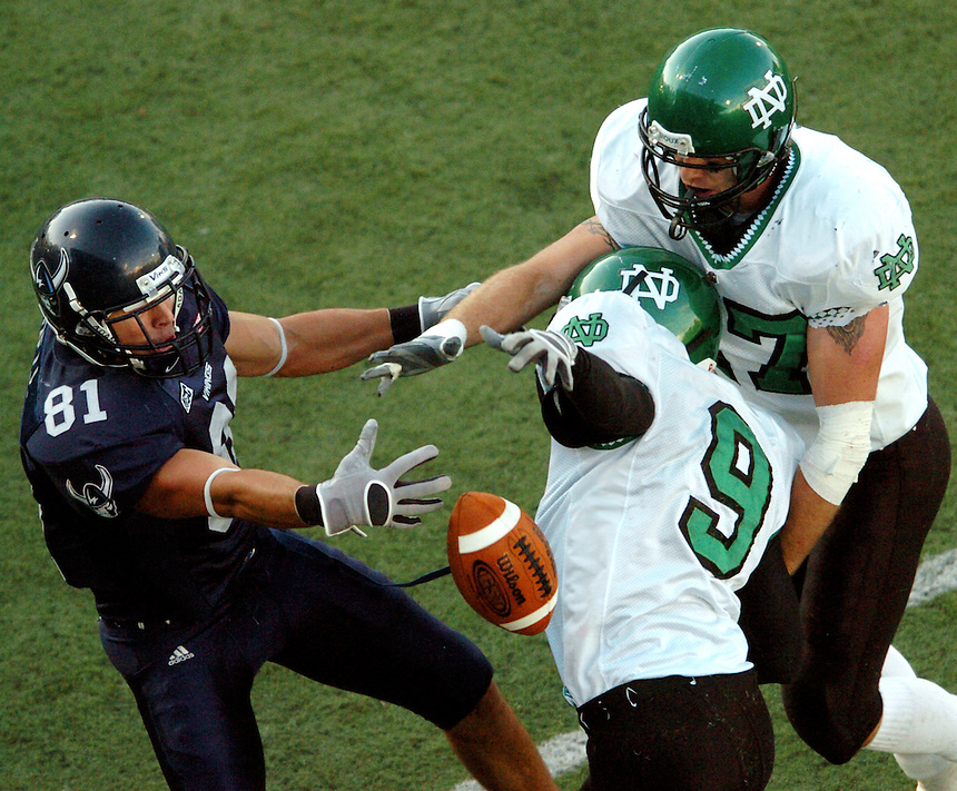 A ten yard pass intended for Western's Casey Dell is broken up by UND's Donovan Alexander (9) and Derek Malner (47) during the first quarter of play of Western's home opener at Civic Stadium on Saturday, September 22, 2007.
