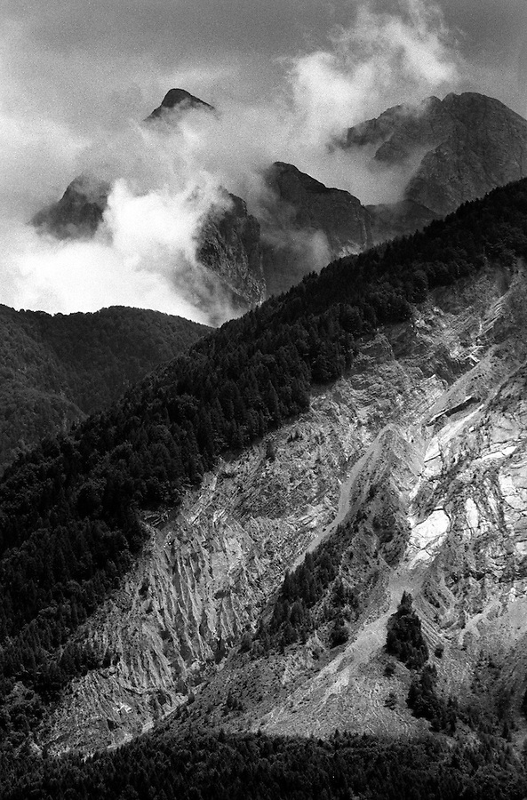 Part of the landslide on Monte Toc. On October 9th 1963 a giant landslide collapses into the artificial lake created by the Vajont Dam in northern Italy, provoking a 250 meters high wave that completely destroys the settlements near the lake and the town of Longarone far down in the valley below the dam. 1910 people lost their lives in a tragedy that easily could have been avoided if it was not for the economical and political interests of powerful men dreaming of the tallest dam in the world. A tragedy that is still alive today in Erto, Casso and Longarone, where the survivers of that disastrous day almost 50 years ago are still fighting for their justice.