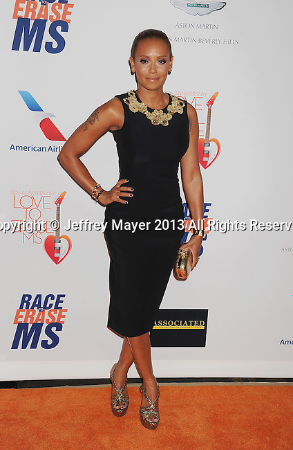 CENTURY CITY, CA- MAY 03:   Singer/TV personality Melanie Brown arrives at the 20th Annual Race To Erase MS Gala 'Love To Erase MS' at the Hyatt Regency Century Plaza on May 3, 2013 in Century City, California.